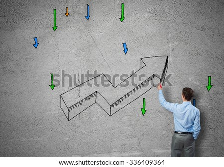 Rear view of businessman drawing increasing graph