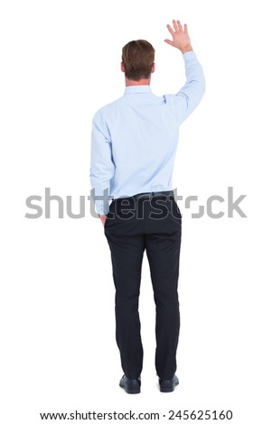 Rear view of businessman in shirt waving on white background