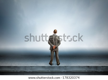 Rear view of businessman looking into distance