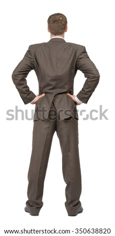 Rear view of businessman on isolated white background - stock photo