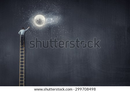 Rear view of businessman standing on top of ladder - stock photo