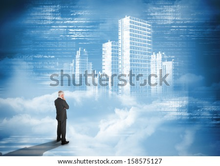 Rear view of businessman standing under holographic city on blue background