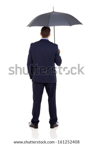 rear view of businessman with an umbrella on white background - stock photo