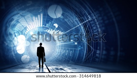 Rear view of businessman with suitcase and diagrams on virtual panel - stock photo