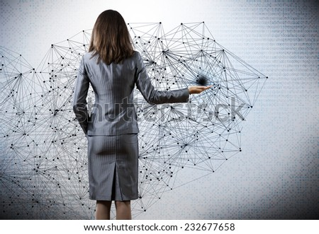 Rear view of businesswoman against digital background - stock photo