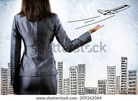 Rear view of businesswoman and travel sketch - stock photo