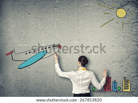 Rear view of businesswoman drawing tarvel sketch - stock photo