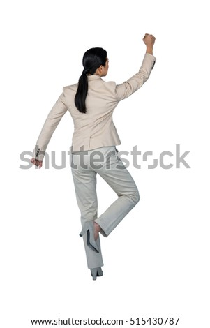 Rear view of businesswoman performing exercise against white background