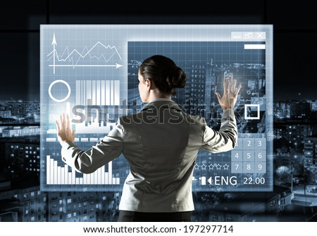 Rear view of businesswoman touching icon of media screen