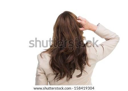 Rear view of classy businesswoman scratching her head on white background - stock photo
