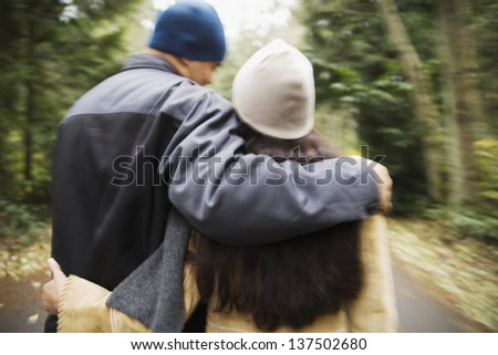 Rear view of couple walking - stock photo