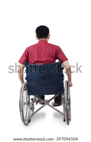 Rear view of disabled person sitting on wheelchair, isolated on white background - stock photo