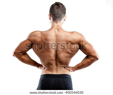 Rear view of healthy muscular young man with his arms stretched out isolated.  - stock photo