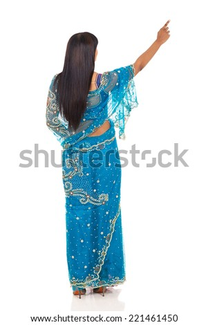 rear view of indian woman pointing empty copy space - stock photo