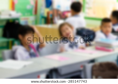 Rear view of little girl in classroom student on blurry,school concept