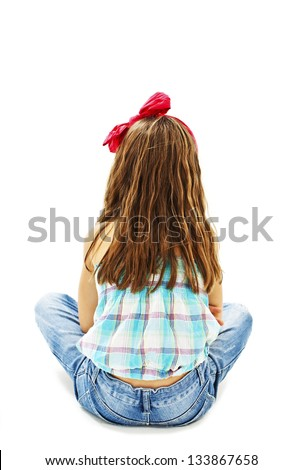 Rear view of little girl sitting on floor. Isolated on white background - stock photo