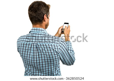 Rear view of man using smartphone on white background