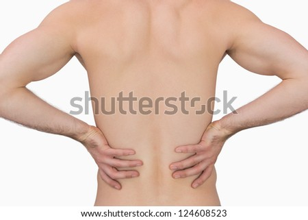 Rear view of muscular man with backache over white background