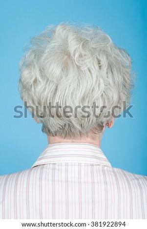 Rear view of senior woman - stock photo