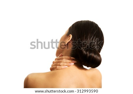 Rear view of slim woman with neck pain. - stock photo