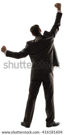Rear view of successful business man with his arms up isolated on white background - stock photo