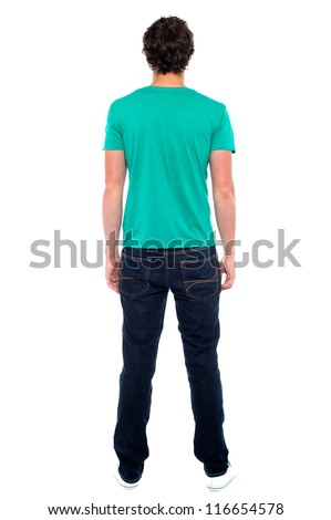 Rear view of teen guy in casuals. Full length portrait - stock photo