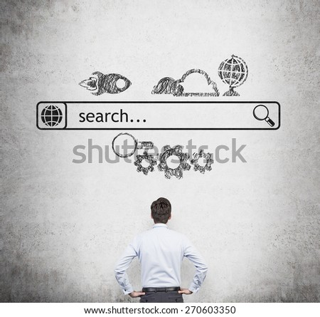 Rear view of the businessman who is looking at the wall with the drawn internet search bar and different icons. A concept of business management process. - stock photo