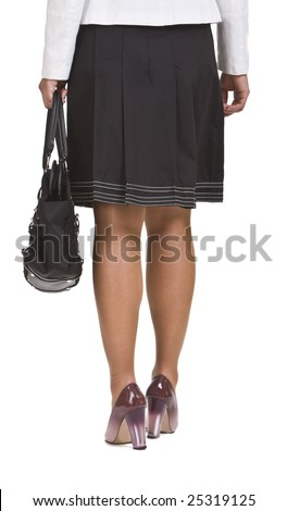Rear view of the lower body part of a woman with a bag. - stock photo