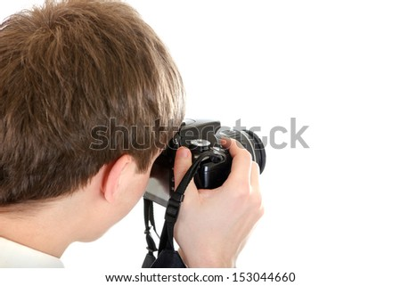 Rear view of the Person Take a Picture with a Camera Isolated on the White Background - stock photo