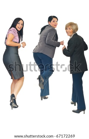 Rear view of three business women running from something or someone  looking back with happy faces isolated on white background