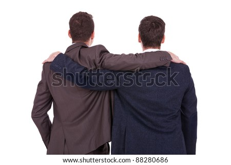 rear view of two young business men friends, over white background