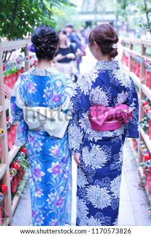 https://thumb1.shutterstock.com/display_pic_with_logo/167494286/1170573826/stock-photo-rear-view-of-wearing-yukata-1170573826.jpg