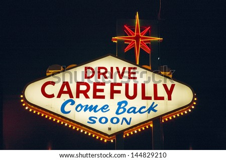 Rear view of Welcome to Fabulous Las Vegas sign at night in Nevada, USA - stock photo