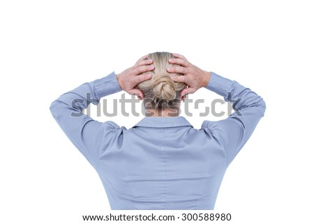 Rear view of worried businesswoman holding her head on white background - stock photo