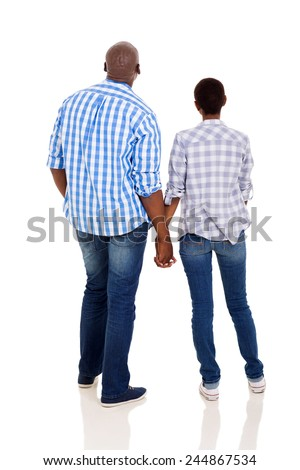 rear view of young african couple holding hands isolated on white background
