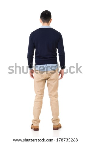 Rear view of young Asian man, full length portrait isolated on white background. - stock photo
