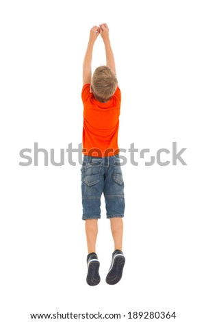rear view of young boy jumping isolated on white background - stock photo