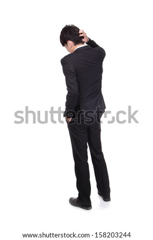 Rear view of young business man confused, isolated over white background, full length portrait of asian businessman standing back - stock photo