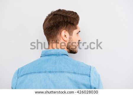 Rear view of young handsome man with bristle in blue shirt - stock photo