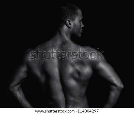 Rear view of young muscular man. Black and white