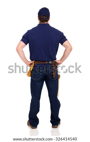 rear view of young repairman isolated on white background - stock photo