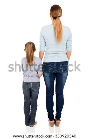 rear view of young woman and her daughter isolated on white background - stock photo