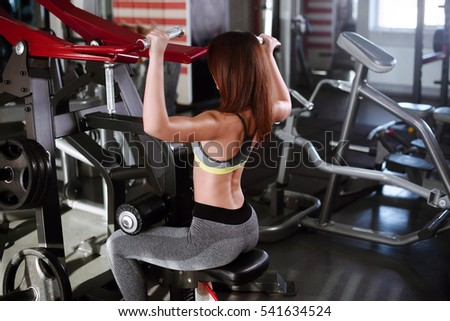 rear view Portrait of young female training in gym