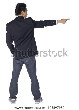 Rear view shot of a pointing teenage male over a white background