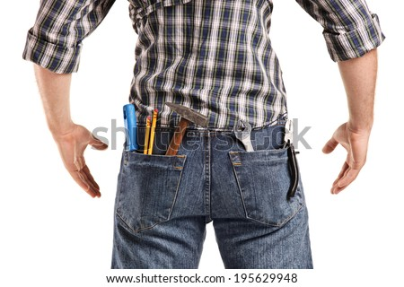 Rear view, studio shot of a man with tools in the pockets of his jeans isolated on white background