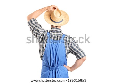 Rear view, studio shot of an agricultural worker isolated on white background