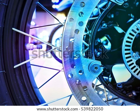 Rear wheel motorcycle with drive chain and disc brake component