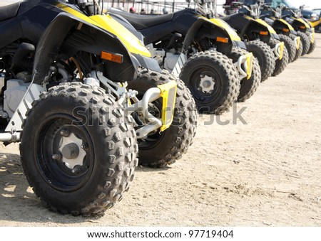 rear wheel of all-terrain vehicle arranged in a row - stock photo