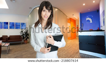 Reassuring medical professional in a clinic reception - stock photo