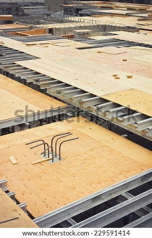 Rebar and metal support beams are used to support a floor under construction. - stock photo